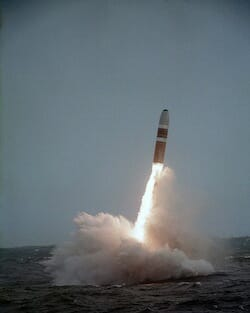 A Trident missile clears the water after launch from a US Navy submarine in 1984 / Wikipedia