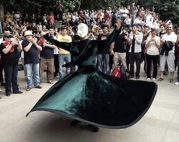 Whirling sufi protester wearing gas mask in a Gezi Protest in Ankara (2 June 2013)