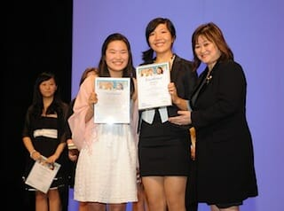 SBCC Winners 2 – Miranda Wang (left) and Jeanny Yao (centre) receive their first place award as regional winners of the 2012 Sanofi BioGENEius Challenge Canada competition from Vancouver South MP Wai Young