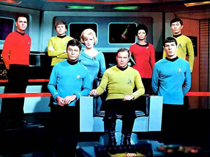 Promotional photo of the cast of Star Trek during the third season (1968–1969). From left to right: James Doohan, Walter Koenig, DeForest Kelley, Majel Barrett, William Shatner, Nichelle Nichols, Leonard Nimoy, and George Takei.