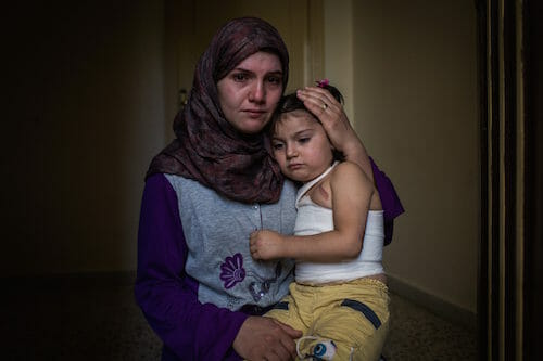 Syrian refugees, Yemen, 5, and her mother, Dayane, 24,