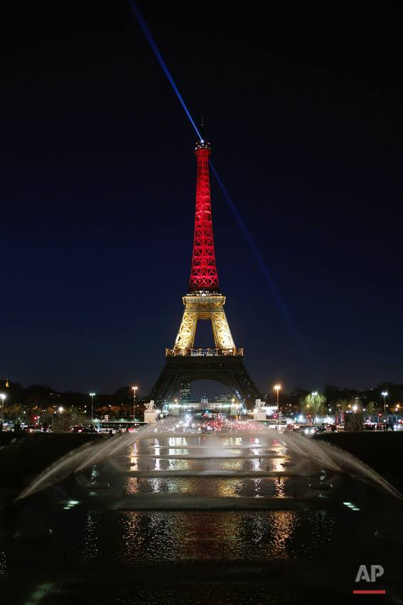 The Eiffel Tower is illuminated with the #Belgium national colors black, yellow and red in honor of the victims of the today's attacks at the airport and the metro station in Brussels, in Paris, Tuesday, March 22, 2016.